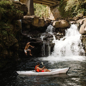 man jumping off waterfall with Oru Kayak Beach LT