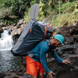 man with Oru Kayak backpack