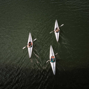 group of Oru Kayak Bay ST in river from above