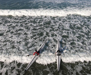 two Oru Kayak Coast XTs in wave foam