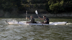 Oru Kayak Haven with two adults and a dog