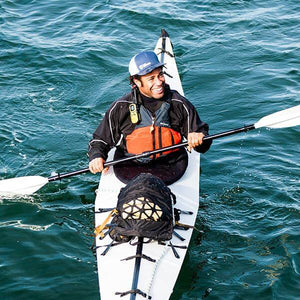 Man kayaking with an Oru Kayak Neoprene Spray Skirt