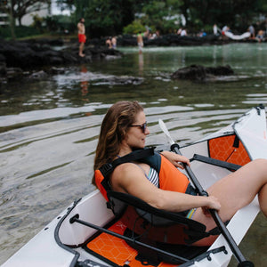 woman sitting in Oru Kayak Beach LT