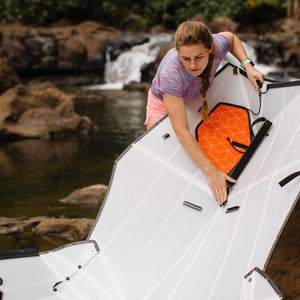 woman unfolding Oru Kayak Beach LT
