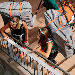 two women wearing Oru Kayak backpacks