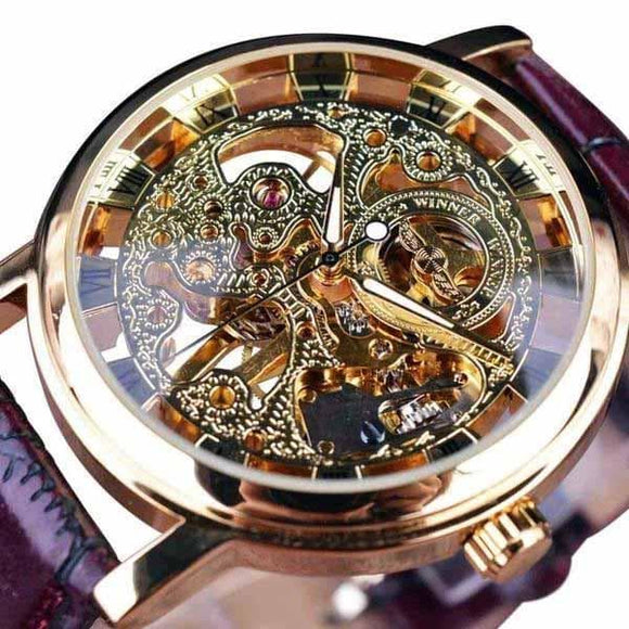 montre automatique squelette or sombre
