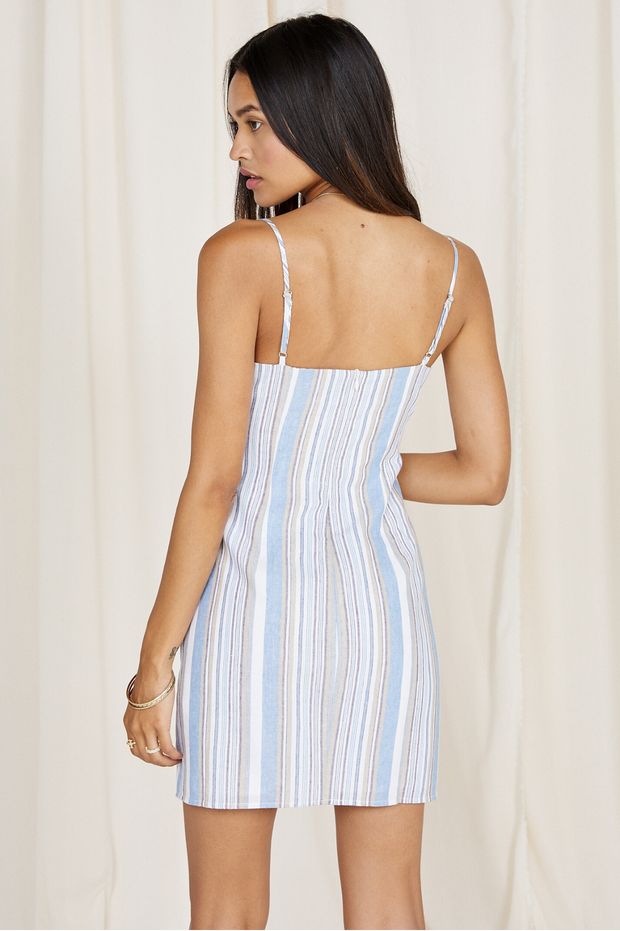 The perfect striped dress for spring or summer! This dress features a tie front detail and includes adjustable straps for the perfect fit. The vertical stripes make for a flattering look.  60% cotton 40% linen