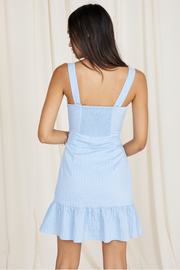 This sky blue dress will have you thinking spring. An added ruffle above the hem and an elastic band on the back for a perfect fit. Lightweight and flirty for a date night or a day out on the town! Button on straps in the back for an adjustable length!  80% rayon 20% polyamide