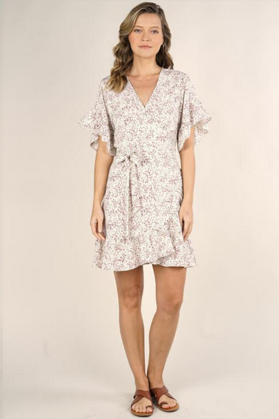 Cute and ruffly, this mini floral wrap dress is ready for spring! The ruffle sleeve and skirt bottom make it a fun addition to your closet. The true wrap design and waist tie ensure this dress flatters your body perfectly.  100% polyester