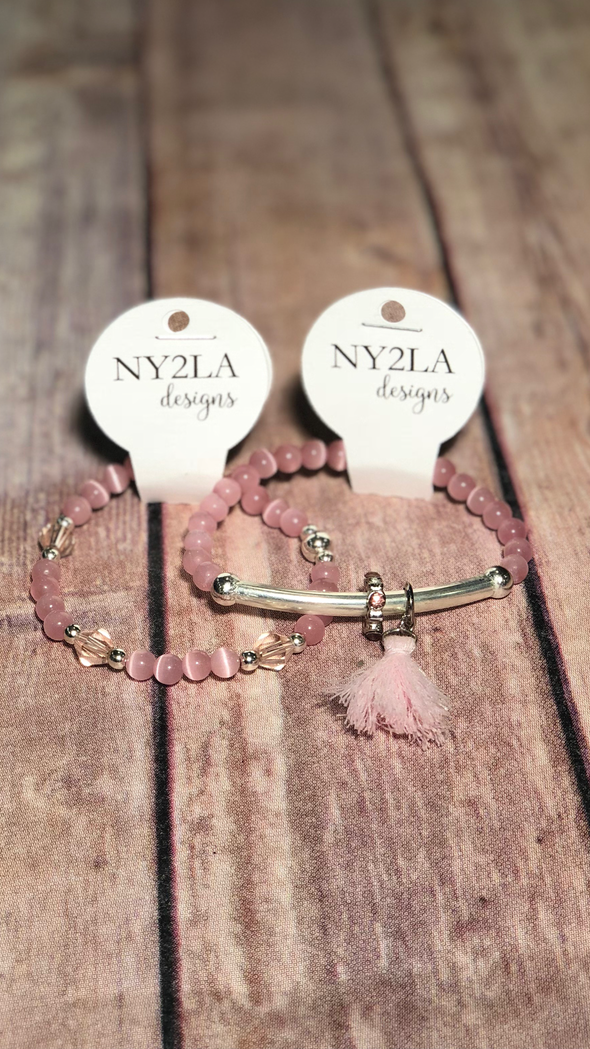 Pink beaded bracelet with bar & charms