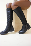 Black knee high buckle boot