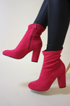 Pink heeled pointed boots