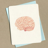 Outside of dirty greeting card shows watercolor of a brain.