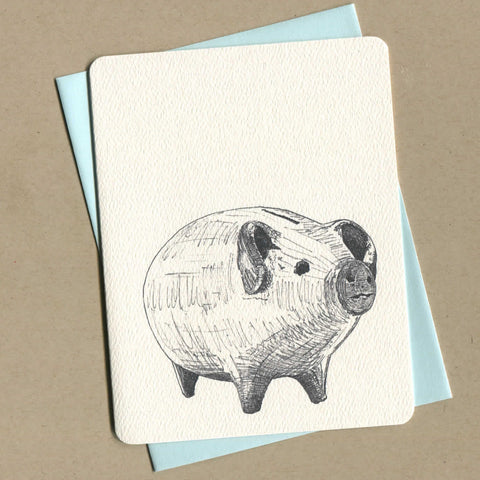 Outside of dirty greeting cards shows black and white illustration of a piggy bank.