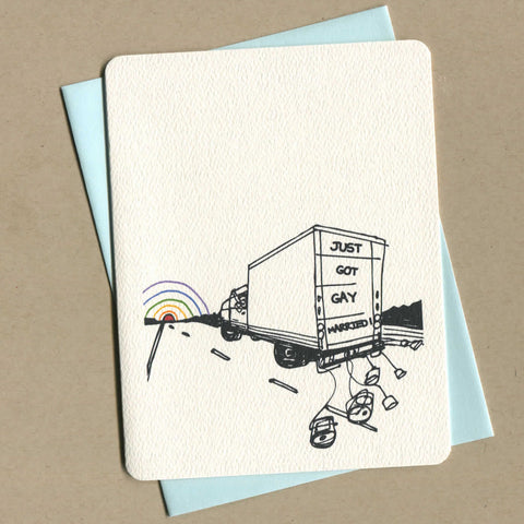 Outside of queer greeting card shows illustration of a UHAUL truck with cans tied to the back, with the words 'just got gay married'