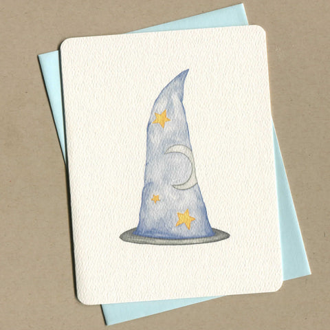 Outside of dirty greeting card shows a watercolor of a wizard hat.