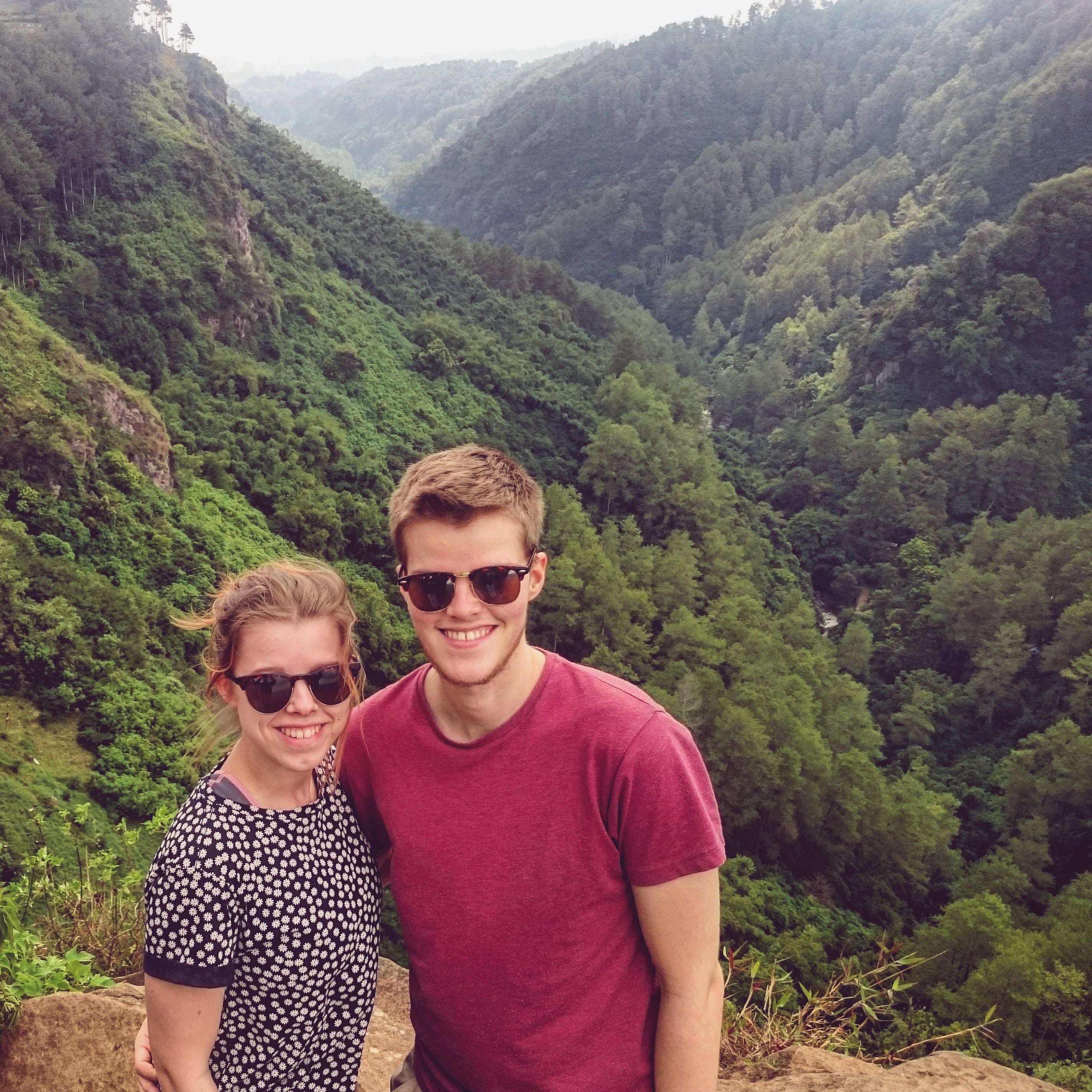 Photo of Styngvi with his girlfriend Kat with Indonesian forest in the background