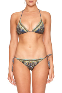 TRI BIKINI WITH BEADS BEHIND CLOSED DOORS