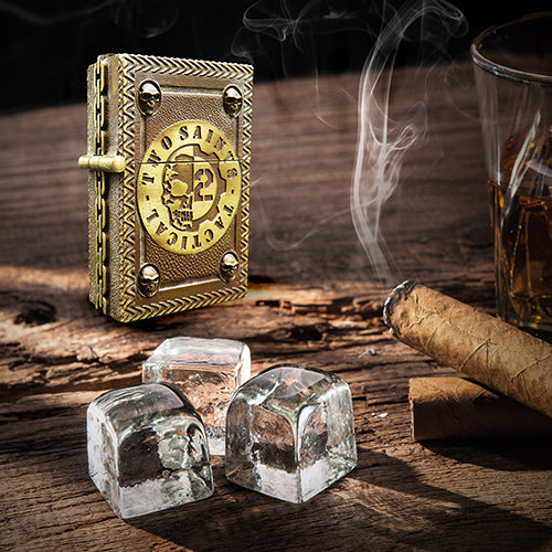 the zippo cover lighter, two saints tactical, placed on a table with a glass of whiskey and a cigar