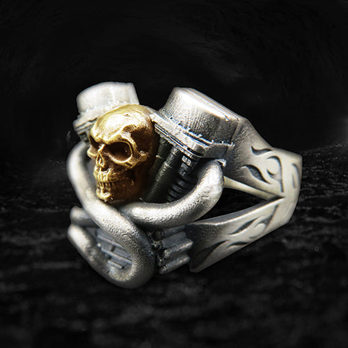 a ring representing the v-twin motor with a skull