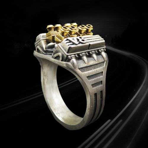 a ring representing the v8 racing motor