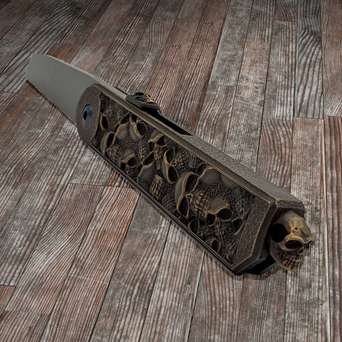 files/el-napo-knife-skull-catacombs-yellow-bronze-home.jpg
