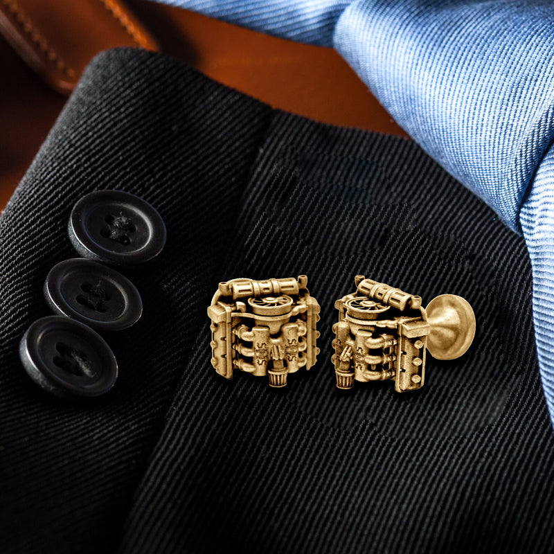cufflinks representing the flat six racing motor