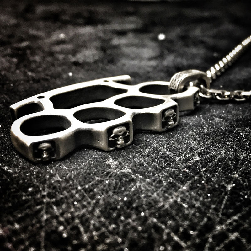 the silver knuckles pendant with skulls