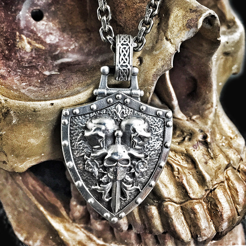 the knights of death pendant placed on a skull