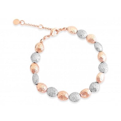 rose gold and silver bracelet with 7.75 inch length, oval shaped balls with battered metal look