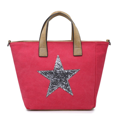 Red canvas tote handbag with silver sequin star motif on the front has adjustable longer strap and interior and exterior back pocket