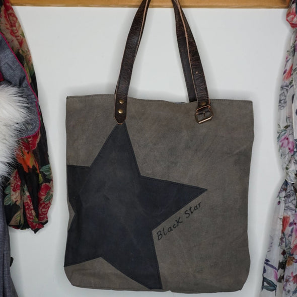 Black and grey star recycled tote bag lifestyle