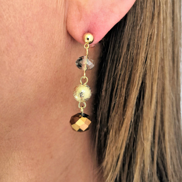 triple gold clear and bronze ball dangly earrings