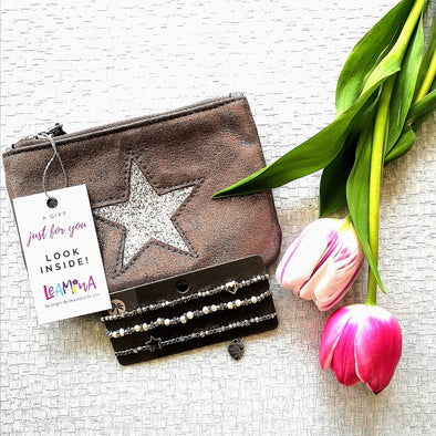 bronze coin purse with silver star and three silver bracelets one with heart one with star and one with cream beads as a gift set at 24.99 with gift tag on purse saying look inside