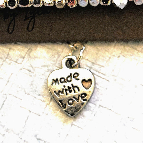 Close up of Made with love heart on bracelet