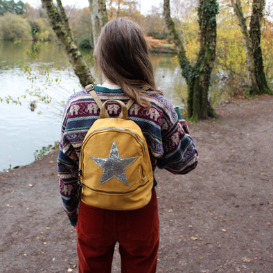 house of milano  small mustard rucksack with silver star motif