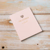 Gorgeous soft pink outer cover with gold leaf writing