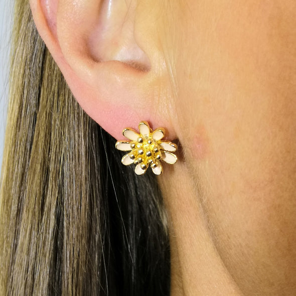 flower stud pierced earrings with gold stamens and peach coloured petals very pretty