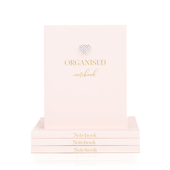 organised notebook with blank pages in pale pink with a raised dimante heart on front