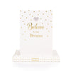 BELIEVE IN YOUR DREAMS SLOGAN ON FRONT OF NOTEBOOK WITH 3D CRYSTAL LOVE HEART AT THE TOPE VERY PRETTY IN PALE PINK AND GOLD WRITING AND DOTS