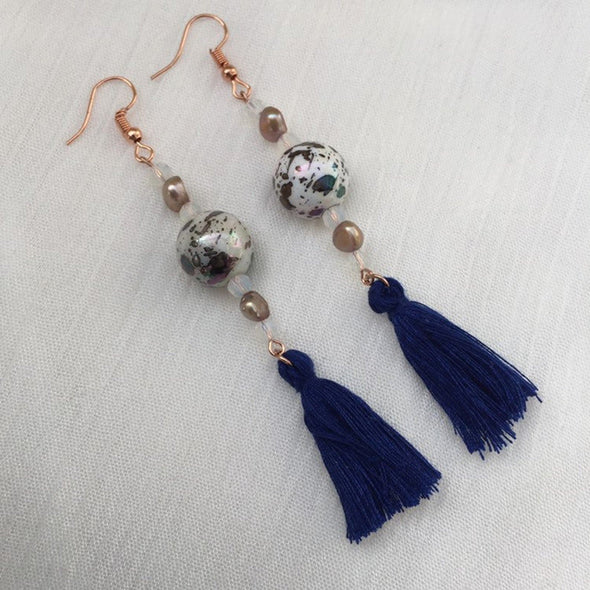 Navy vintage style earrings with beads and tassels side view