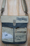 Recycled cross body airmail logo bag lifestyle