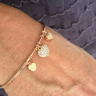 rose gold bangle with three love hearts 2 plain and one crystal very easy to get on