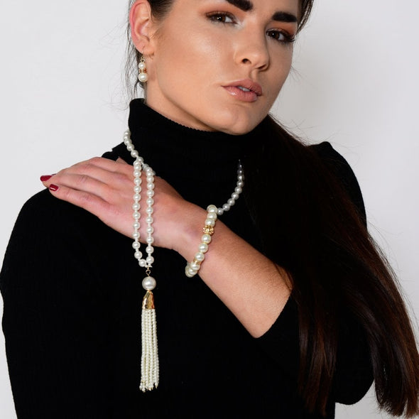 Long gold plated pearl tassel necklace on model