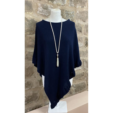 pearl necklace worn with navy cashmere mix poncho