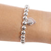 Silver Ball Bracelet with Double Rose Gold and Silver Heart Charm on writst