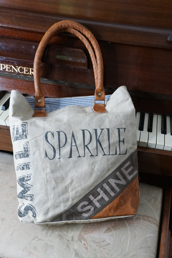 smile sparkle shine logo recycled shopper lifestyle