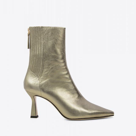 Gold metallic ankle heeled boots by Lola Cruz