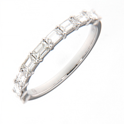 Wedding band with emrald cut diamonds