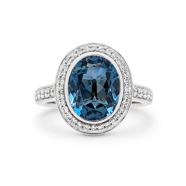 Blue Topaz & Diamond Bezel Set Halo Ring